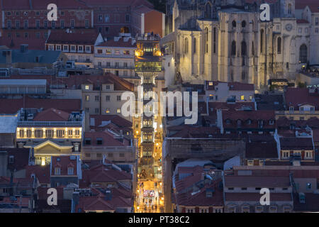 Portugal, Lisbon, Elevador de Santa Justa and ruin of Convento do Carmo, night shot from Castelo de S. Jorge - Stock Photo