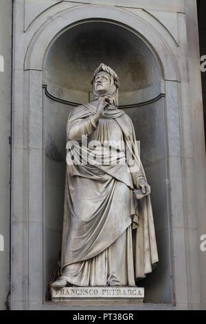 Italian Renaissance scholar and poet Francesco Petrarca. Marble statue by Italian sculptor Andrea Leoni on the facade of the Uffizi Gallery (Galleria degli Uffizi) in Florence, Tuscany, Italy. - Stock Photo