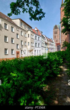 House facade, church tower, St. Georgen Church, Wismar, Baltic Sea coast, Mecklenburg-Vorpommern, Germany, Europe - Stock Photo