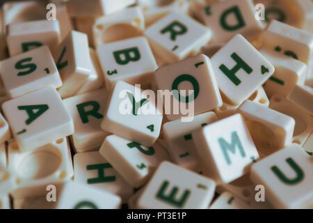 Bangkok, Thailand - September 25, 2018 : A pile of Scrabble letter tiles . - Stock Photo