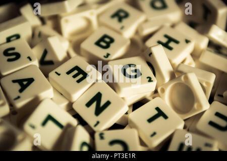 Bangkok, Thailand - September 25, 2018 : A pile of Scrabble letter tiles. - Stock Photo
