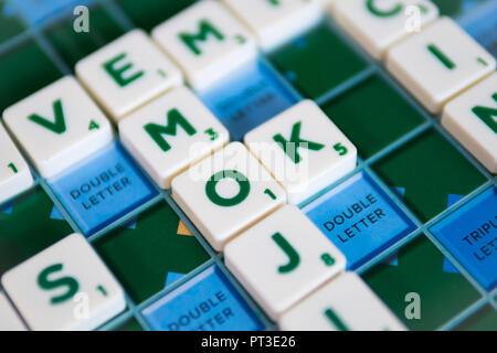 Bangkok, Thailand - September 25, 2018 : People playing Scrabble game by use the letter tiles to make words. - Stock Photo
