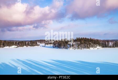 Coasts of Saimaa lake. Rural winter landscape, Finland - Stock Photo
