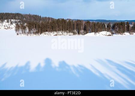 Coastal winter landscape of Saimaa lake. Winter in Finland - Stock Photo