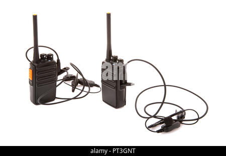 Pair of Walkie Talkie 2 way radios with headsets on a white background - Stock Photo