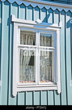 RAUMA, FINLAND - JULY 6, 2013: White lace in the window. Rauma is famous for high quality lace (known from the XVII century). - Stock Photo
