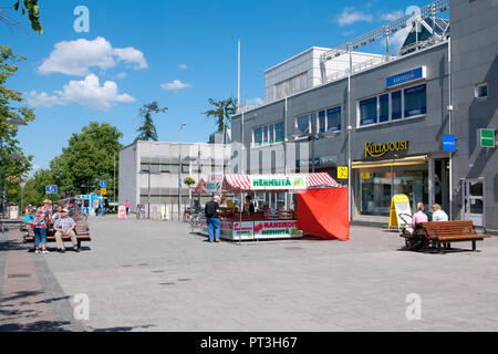 LAPPEENRANTA, FINLAND - JUNE 15, 2016: People sit on the benches and buy strawberry on the Oleksi pedestrian zone - part of the Kauppakatu Street - Stock Photo