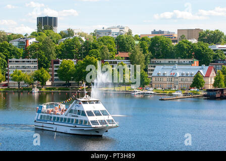 LAPPEENRANTA, FINLAND - JUNE 15, 2016: People sail on the white boat to harbor on Saimaa Lake. View from Linnoitus Fortress - Stock Photo