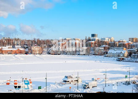 LAPPEENRANTA, FINLAND - FEBRUARY 18, 2010: Winter landscape with boats in harbor  on Saimaa Lake. View from Linnoitus Fortress. - Stock Photo