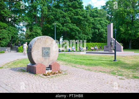 LAPPEENRANTA, FINLAND - JUNE 15, 2016: People sit on the benches near Memorial to orphans of wars next to The Central Park. - Stock Photo