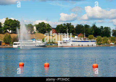 LAPPEENRANTA, FINLAND - AUGUST 8, 2016:  Summer landscape with white boats in Lappeenranta Harbor on Saimaa Lake. - Stock Photo