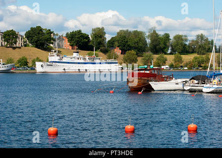 LAPPEENRANTA, FINLAND - AUGUST 8, 2016:  Summer landscape with white boat and yachts in Lappeenranta Harbor on Saimaa Lake. - Stock Photo