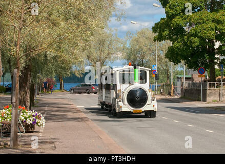 LAPPEENRANTA, FINLAND - AUGUST 8, 2016: Excursion Fun Train on the one of the streets near Saimaa Lake - Stock Photo