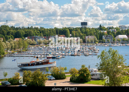 LAPPEENRANTA, FINLAND - AUGUST 8, 2016: People sail on a boat to Lappeenranta Harbor on Saima Lake. View from Linnoitus Fortress - Stock Photo