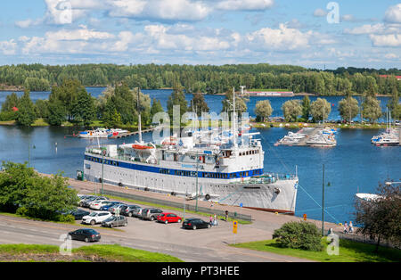 LAPPEENRANTA, FINLAND - AUGUST 8, 2016:  Summer landscape with white boat in Lappeenranta Harbor on Saimaa Lake. View from Linnoitus Fortress - Stock Photo