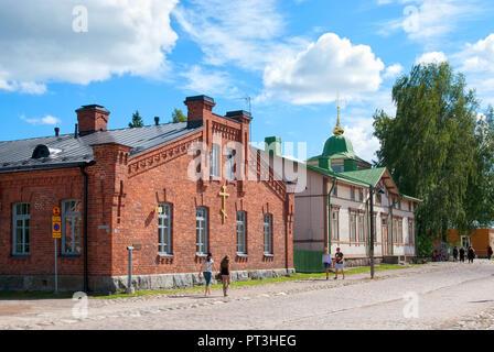 LAPPEENRANTA, FINLAND - AUGUST 8, 2016: People walk near Orthodox parish building and church priest house. Last Fortress territory. - Stock Photo