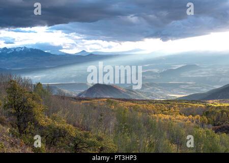 Colorado Sunset Splashes Autumn Color on Groves of Aspen Trees - Stock Photo