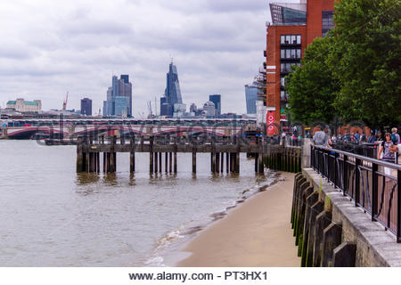 A view towards central London along the South Bank - Stock Photo