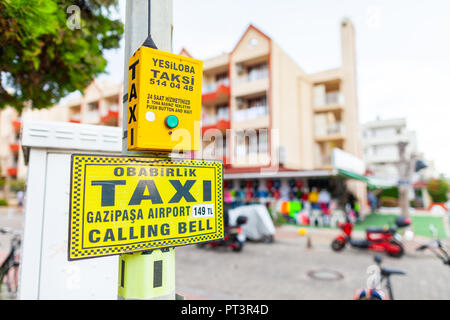 ANTALYA / TURKEY - SEPTEMBER 29, 2018: Turkish Taxi calling sign stands on a street in Antalya - Stock Photo