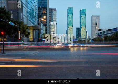 High-rise buildings in Futian Central Business District (CBD) illuminated at dusk. Shenzhen, Guangdong Province, China. - Stock Photo