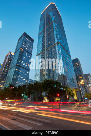 High-rise buildings in Futian Central Business District (CBD) illuminated at dusk. Shenzhen, Guangdong Province, China.