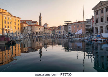 Venetian Port and The Main Square Tartini of Piran City at the sunriste reflected on Water in Slovenia. - Stock Photo