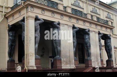 The huge Atlantes statues that hold up the portico at the rear entrance to the Hermitage museum in St Petersburg, Russia. - Stock Photo