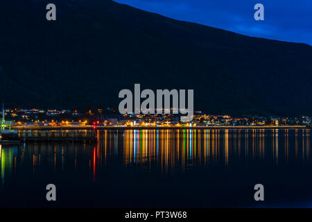 Night view across Tromsoysundet strait with Tromsdalen on mainland - long exposure. - Stock Photo