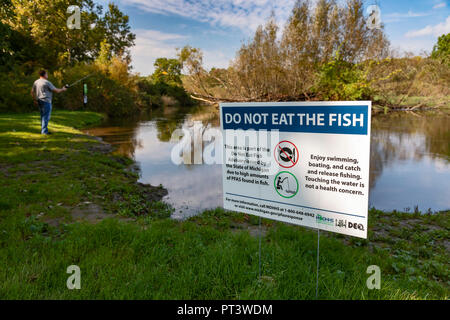 Brighton, Michigan - A sign at Island Lake State Recreation Area warns anglers not to eat fish from the Huron River. High levels of PFAS chemicals hav - Stock Photo