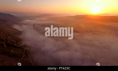 Morning mist over the Mosel valley near Lieser, Moselle valley, Rhineland-Palatinate, Germany, aerial view - Stock Photo
