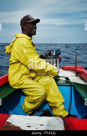 Vila do Maio ,Maio Island, Cape Verde - Jan 5 2016: local fisherman going out to sea to fish for yellow fin tuna or wahoo in a traditional colorful di - Stock Photo