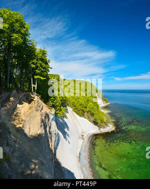 Germany, Mecklenburg-Western Pomerania, Rügen Island, Jasmund National Park, view from the high shore to the Baltic Sea and the chalk cliffs, spring, beech forest on the steep bank, fresh green - Stock Photo