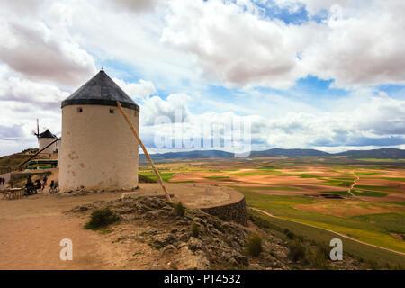Windmills in the green inland, Consuegra, Don Quixote route, Toledo province, Castile-La Mancha region, Spain - Stock Photo