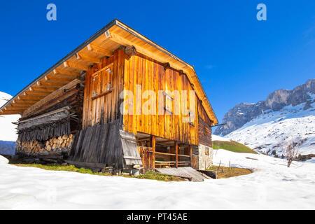 Typical huts in Partnun with Ratikon mountain range in the background, Partnun, Prattigau valley, District of Prattigau / Davos, Canton of Graubünden, Switzerland, Europe, - Stock Photo