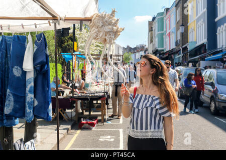 Shopping in Portobello Road Market, Notting Hill, London, United Kingdom - Stock Photo