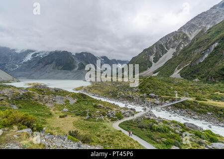 Hikers on Hooker Valley track, Mount Cook National Park, Mackenzie district, Canterbury region, South Island, New Zealand, - Stock Photo