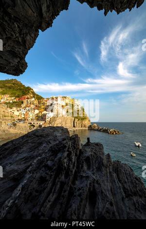 View of Manarola village from the cave, La Spezia district, Liguria, Italy - Stock Photo