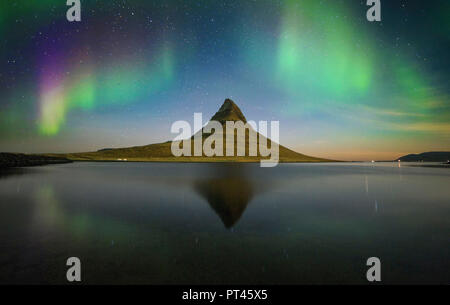 Aurora Borealis in Kirkjufell mountain, Grundarfjordur village, Iceland, - Stock Photo