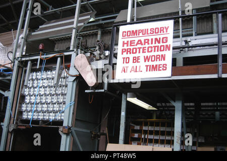 COMPULSORY HEARING PROTECTION SIGN IN A CANNERY FACTORY, TASMANIA. AUSTRALIA. - Stock Photo