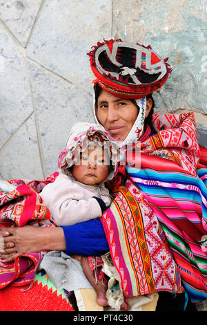CUSCO, PERU - 04 APRIL 2012: Sad and poor Peruvian children in traditional garments in the Sacred Valley in South America - Stock Photo