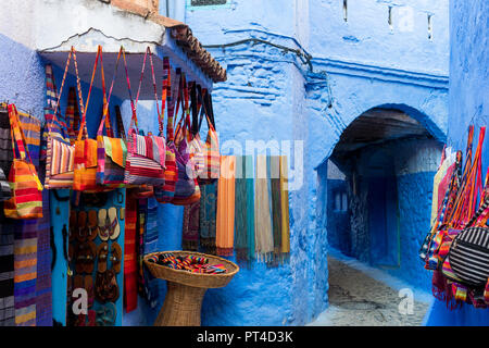 Souvenir sale on the street in Chefchaouen in Morocco - Stock Photo