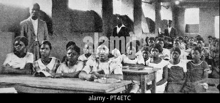EDUCATION - African girls and women being educated in a new school for females in Angola, c1940's - Stock Photo