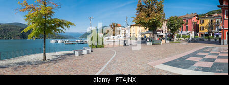 Picturesque village, lake promenade and historical center, with restaurants and bars, in Porto Ceresio (square Bossi), Lake Lugano, Italy - Stock Photo