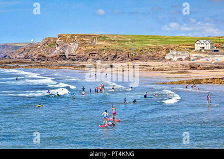 6 July 2018: Bude, Cornwall, UK - Crowds cooling off in the sea during the summer heatwave. - Stock Photo