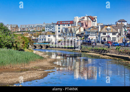 6 July 2018: Bude, Cornwall, UK - Homes and businesses in the seaside town, reflected in the River Neet, on a hot summer day. - Stock Photo