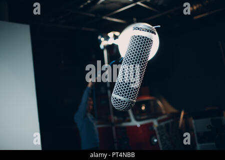 Sound engineer holding a microphone - Stock Photo