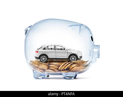 Car miniature on money inside transparent piggy bank with clipping path - Stock Photo