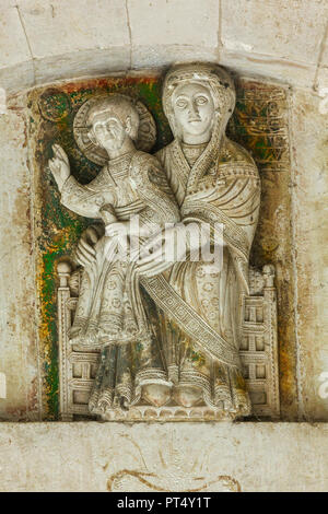 low relief of the Madonna with Child in throne. Abruzzo - Stock Photo