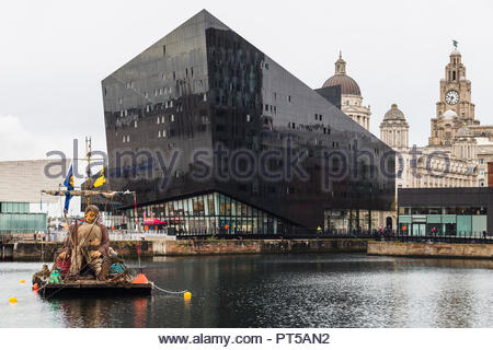 Liverpool, UK. 7th October 2018. Giant man aboard his raft in Canning Dock.  Captured on day two (Saturday 6th October 2018) in Liverpool during Liverpool's Dream - the final saga of the Giants by Royal De Luxe. Credit: Jason Wells/Alamy Live News - Stock Photo