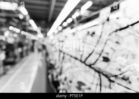 Abstract blurred manufacturing area at factory, background for industry, monochrome effect - Stock Photo
